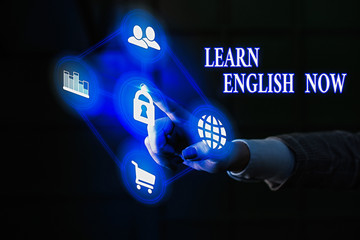 Conceptual hand writing showing Learn English Now. Concept meaning gain or acquire knowledge and...