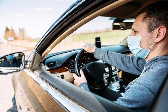 Man in the medical mask in car. coronavirus, disease, infection, quarantine, covid-19