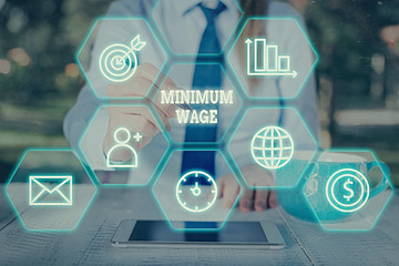 Word writing text Minimum Wage. Business photo showcasing the lowest wage permitted by law or by a special agreement