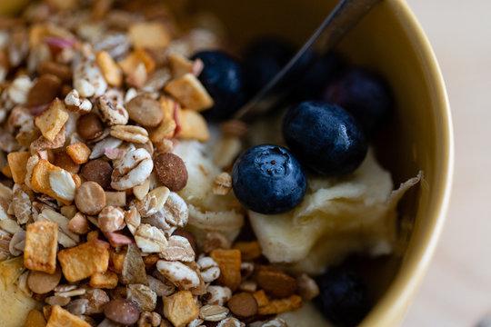 Breakfast bowl. Yogurt, cereals, berries and banana