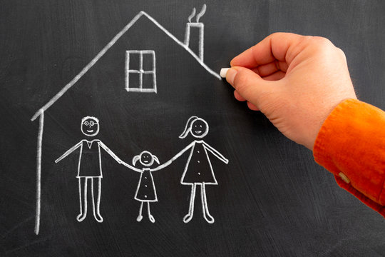 Teaching child, to stay at home in enjoyable and recreation way to keep social distance. drawing to chalk board.