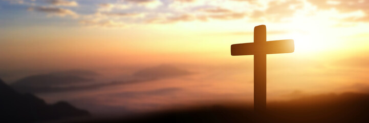 Silhouette of catholic cross at sunset background. panorama picture