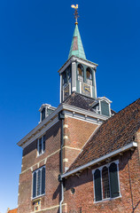 Fotomurales - Tower of the historic weigh house in Frisian village Makkum, Netherlands