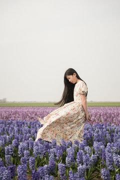 Portrait of asian girl in flowerfield