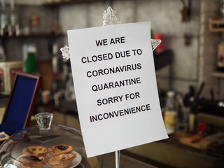 Biohazard concept of living in a new reality of coronavirus epidemic hysteria cafe owner sticks...