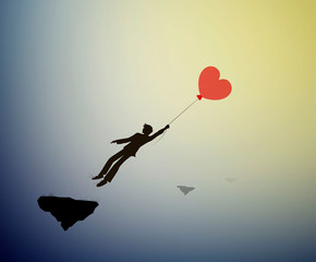 fall in love concept, boy silhouette holds the red heart shaped balloon and flying up to sun, dreamer concept, shadow story