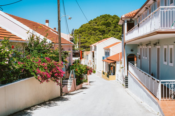 Narrow street in a picturesque Assos town, Kefalonia. Greek island. Summer holiday vacation in...