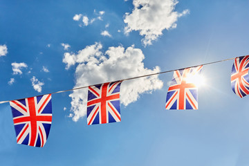 British Union Jack bunting flags against blue sky Fotomurales
