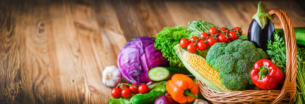 Variety assorted raw organic fresh vegetables wide banner. Assortment of fruits and vegetable. Healthy raw detox food diet panorama concept.