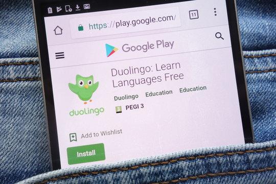KONSKIE, POLAND - JUNE 09, 2018: Duolingo app on Google Play website displayed on smartphone hidden in jeans pocket