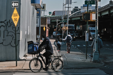 A delivery man wears a mask on 3rd avenue in the Brooklyn borough of New York City, U.S.