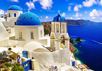 Iconic Santorini - most beautiful island in Europe. view with traditional churches in Oia village. Greece Fototapete