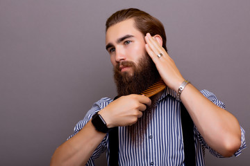 man combing his beard