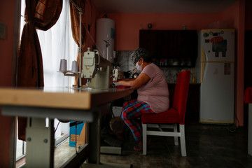 Hilda Acosta, a volunteer at a soup kitchen, sews face masks for the low-income people at her home, during the spread of the coronavirus disease (COVID-19), in Florencio Varela, in the outskirts of Buenos Aires