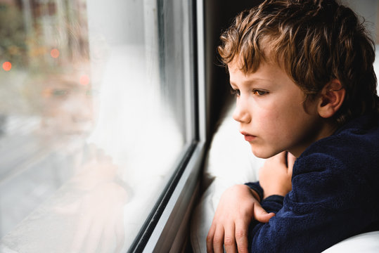 Boy stays home bored by school closings due to covid pandemic.