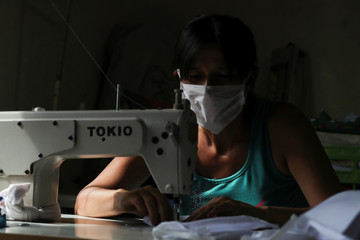 A volunteer of a soup kitchen sews face masks for the low-income people at her home, during the spread of the coronavirus disease (COVID-19), in Florencio Varela, in the outskirts of Buenos Aires