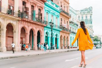 Papiers peints La Havane Tourist girl in popular area in Havana, Cuba. Back view of young woman traveler smiling