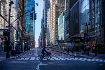 A person rides his bike through the near empty streets near Grand Central due to health concerns to stop the spread of Coronavirus in New York City on Tuesday, March 24, 2020. (Photo: Gordon Donovan). Fotomurales
