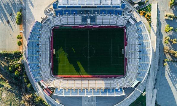 Nicosia, Cyprus - 25/12/2017: Aerial bird's eye view of GSP football stadium at Latsia. The soccer field, athlete track, seats and pitch of Pancyprian Gymnastic Association Stadium from above.
