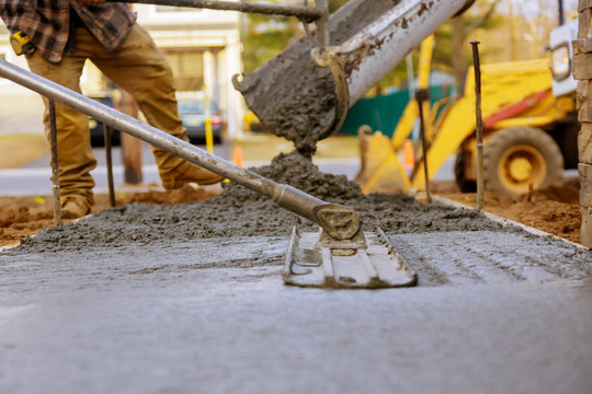 Worker working for concrete pavement for ground construction