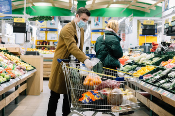 a man in a medical mask buys food at a grocery store. Coronavirus, virus, infection, epidemic, pandemic. RUSSIA, RUSSIA-MARCH 19, 2020. OBNINSK