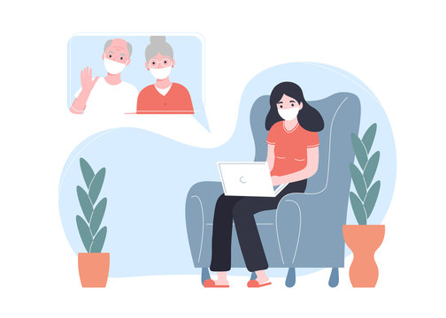 Girl in a protective medical mask girl communicates on the internet online with grandparents. Stay home concept. Ncov, covid 2019, prevention Coronovirus concept. Novel coronavirus pandemic.
