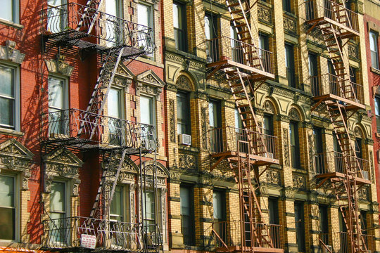 New York Typical Building Facades With Fire Escape Stairs