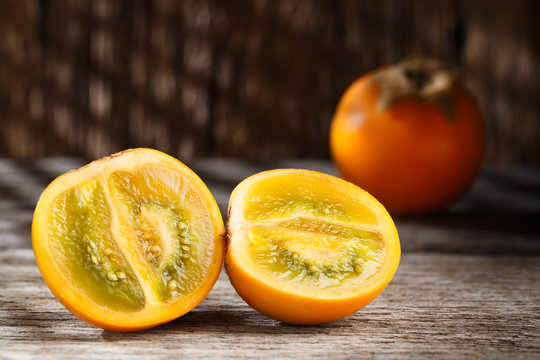 Fruit of lulo or naranjilla on wood