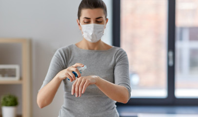 hygiene, health care and safety concept - close up of woman wearing protective medical mask...