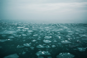 Cold azure sea with broken ice