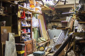 Big mess in an over stuffed suburban garage.