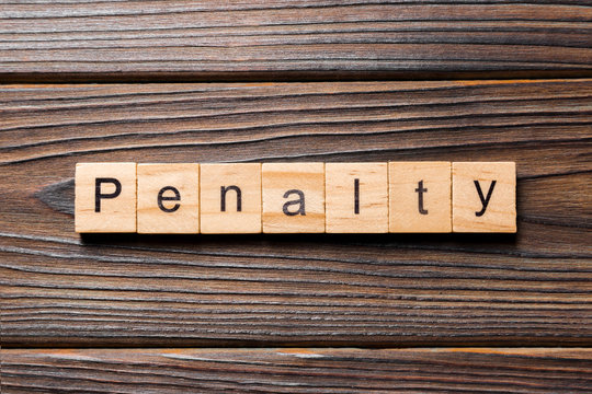 PENALTY word written on wood block. PENALTY text on wooden table for your desing, concept
