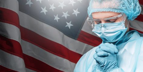 a doctor who is tired after a hard day, the doctor prays against the backdrop of the American flag...