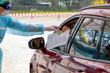 Patient in a car on a coronavirus test station