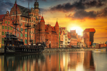 Beautiful old town with historical port crane in Gdansk over Motlawa river at sunset, Poland.