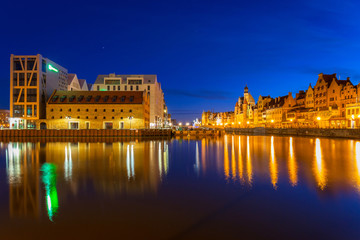 Old town in Gdansk with reflection in Motlawa river at night, Poland.