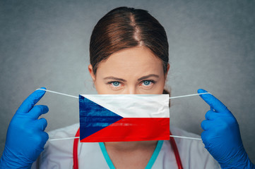 Coronavirus in Czechia, Czech Republic Female Doctor Portrait hold protect Face surgical medical mask with Czech Republic National Flag. Illness, Virus Covid-19 in Czech Republic, concept photo