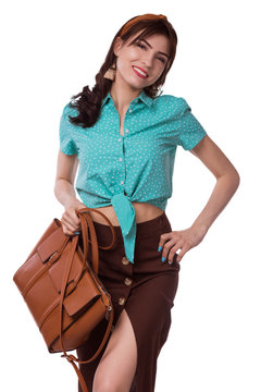 Elegant fashionable woman with leather handbag. Stylish pin-up girl holding brown bag. Female fashion vogue. Retro style. White background. Isolate