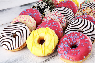 Wall Mural - donuts in different glazes with chocolate, sprinkles and stripes