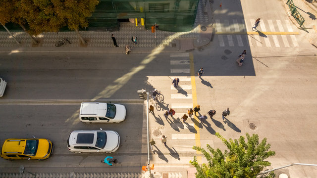 Urban street view from above in Eskisehir with pedestrians and cars