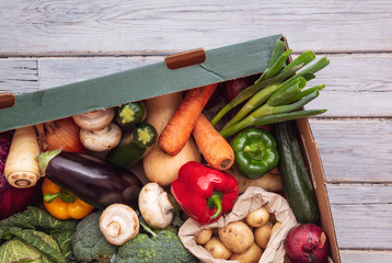 Fresh organic vegetable delivery box on a wooden background Wall mural