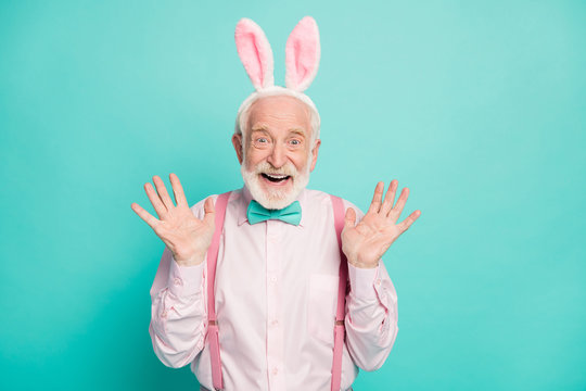 Portrait of funky crazy excited old man look incredible easter party discounts impressed scream wow omg wear pink outfit hare headband isolated over teal color background