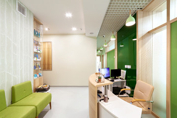 Lobby entrance with reception desk in a dental clinic.
