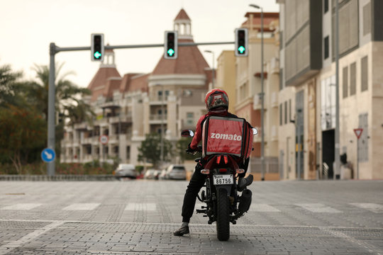 A delivery man drives a motorcycle, following the outbreak of coronavirus disease (COVID-19), in Dubai
