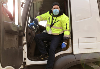 young transporter on the truck with face mask and protective gloves for Coronavirus Fotobehang