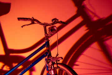 Foto auf Leinwand Fahrrad Antique bicycle with isolated front light on colored background. Old bike concept