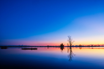 Canvas Prints Dark blue Beautiful, calm lake at sunset with a reflection.