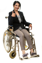 Businesswoman in wheelchair giving thumbs