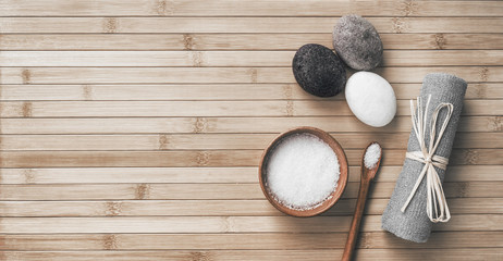 Bath salts natural spa products top view on bamboo wooden texture background with copy space for...