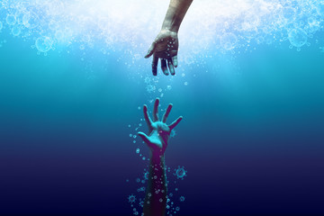 a helping hand saving the drowning victim from the coronavirus, the bubbles in coronavirus shape, idea, conceptual images.